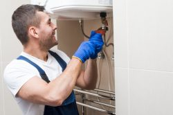 cheerful-plumber-working-bath_23-2147772231
