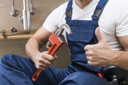 crop-plumber-gesturing-thumb-up_23-2147772214