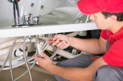 male-plumber-fixing-sink-pipe-bathroom_85574-3373